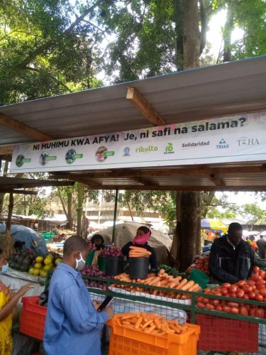 A kiosk at Kilimbero market in Arusha promoting safe fruit and vegetables